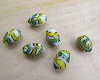 Glass Lampwork bead 18 x 12 mm, oval shaped, multicolored design.