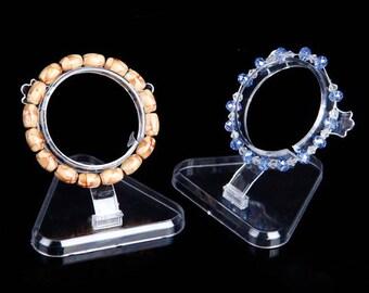 Clear Plastic Bracelet Display Transparent Size: about 80mm Long x 80mm Width x 55mm Diameter