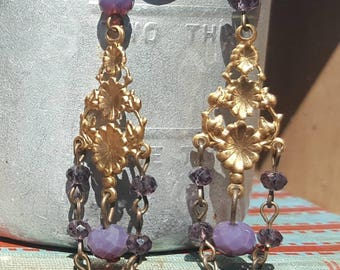 Gold filigree chandelier earrings featuring repurposed purple stones.