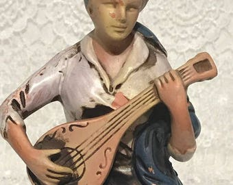Vintage Figurine Woman Siting in a Tree Stump Playing the Guitar From Arcadia