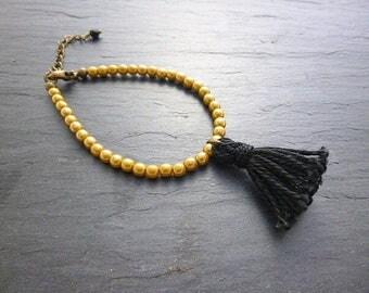 Bracelet glass beads and bronze/black tassel