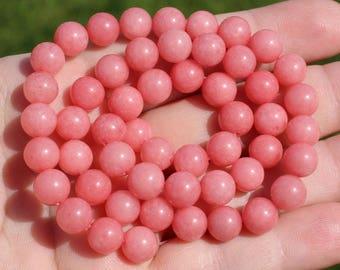 2 beads has 8 mm round Rhodochrosite *.
