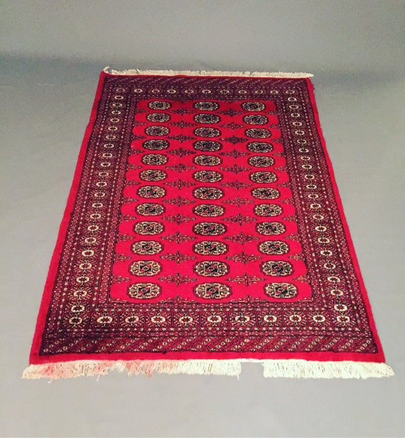 Pre Owned hand knotted woolen Bukhara rug