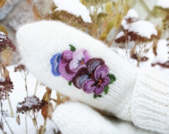 Women hand knit wool mittens with a flowers picture