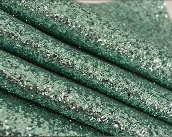 Glitter fabric, pale green.Pale green chunky glitter fabric. Bow making fabric. Just pale green