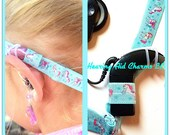 Adjustable Athletic Hearing Aid and Cochlear Implant Headband Wraps by Rockin Aid Retainers!  Non slip silicone grip!