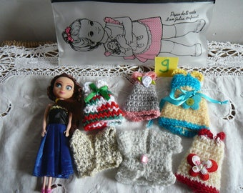 9/small doll and her wardrobe.