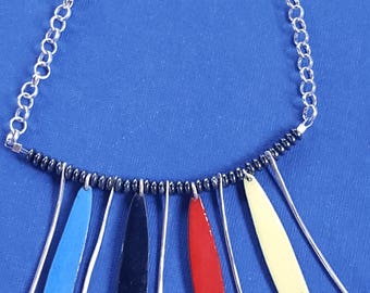 Colorful handmade enameled pieces with Sterling  silver necklace.