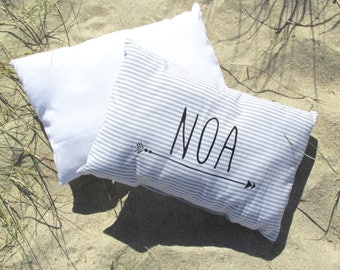 Gray and white, personalized arrow striped cushion.