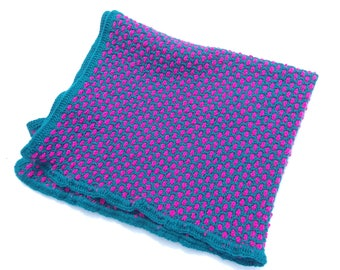Teal and Pink Crochet Baby blanket. Measures 42 inches by 30 inches.