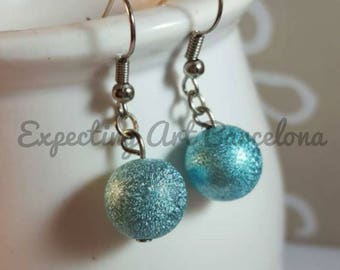 Bronze earrings with blue ball