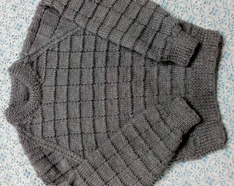 Lovely grey jumper hand knitted in eight ply acrylic in size four