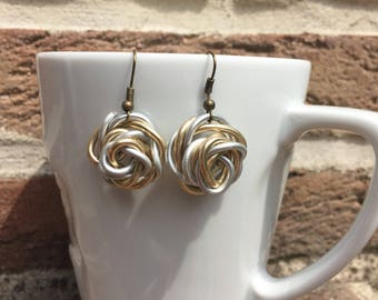 Aluminum Silver/Gold color jewelry/earrings in the shape of rose