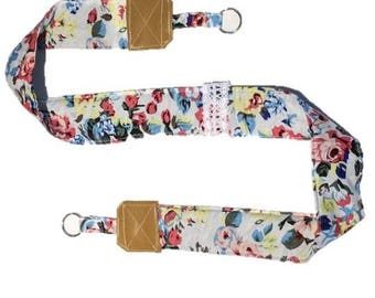Strap from camera fabric with blue flowers and leather