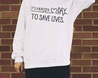Its a beautiful day to save lives white sweatshirt! Greys anatomy.