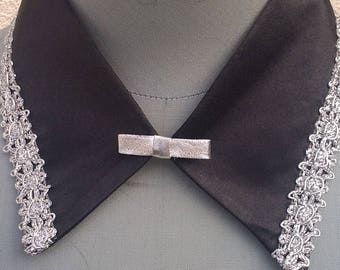 Removable black satin collar lined with a Silver Ribbon with bow.