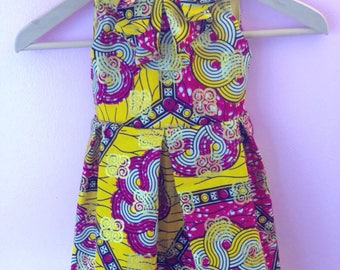 Dress has ruffled pink yellow pleated wax gold lined baby child