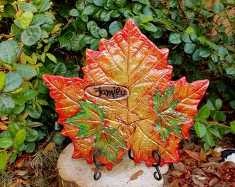 "Sycamore Leaf & Maple leaves casting decorative accent piece.  Handpainted in Fall Colors, with wooden inlay that stating, ""Family""."