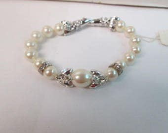 "7 "" Faux Pearl with  crystal accents Brand new never worn with tags."