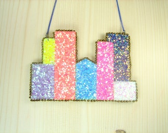 "Glitter ""The city of light"" bib necklace."
