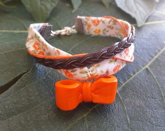 Orange floral bracelet and a small knot