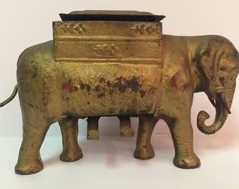 Vintage elephant cigarette dispenser