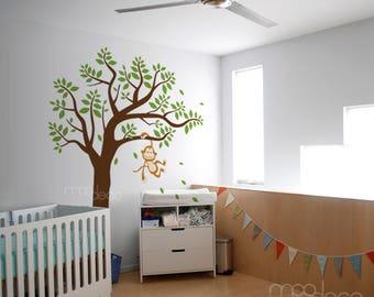 Cute Little Monkey Swinging on tree branch having fun wall decal nursery and playroom sticker