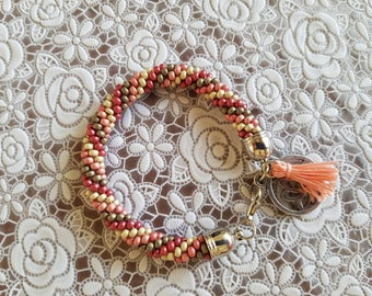 Bracelet crochet, pink, beige and gray.