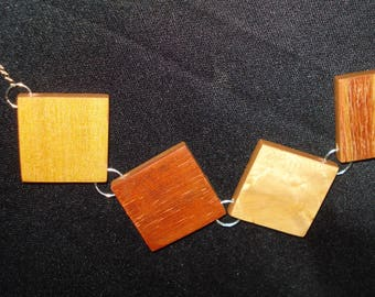 """To the Reverse"", wood veneer jewelry collection"