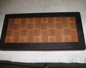 Walnut and walnut end grain cutting board