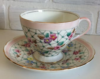 Foley English Tea Cup and Saucer vintage pink band flowers on netted spider web