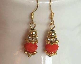 Red orange earrings. Red dangle earrings. Orange dangle earrings. Dangle earrings.  Drop earrings. Gold embellishment on gold ear wires.