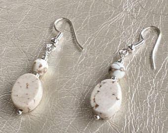 Creme beige dangle earrings.  Hanging on a silver ear wire.