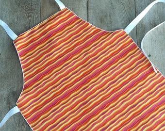 kid-sized apron, children's apron, cooking gear, kids' kitchen supplies