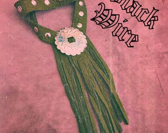 Green leather choker with fringe , rivets and concho , snap button