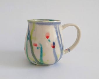 Ceramic mug, handmade, watercolor, comtemporary floral design, colorful, red, blue, lime green, leaf green, coffee mug, tea, hot chocolate