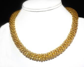 Sophisticated and elegant gold beaded necklace
