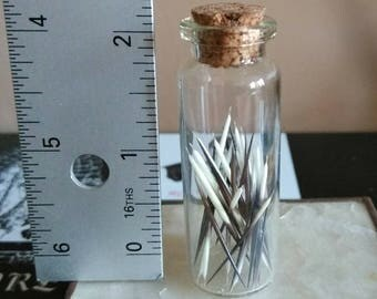 "2"" vial of porcupine quills"