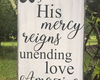 His mercy reigns distressed wood sign