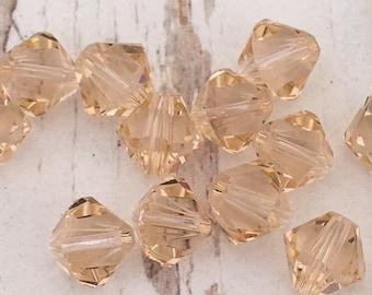 SALE!    4 Light Peach Swarovski Crystal Bicone Beads, 5mm