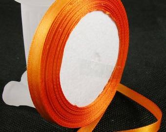 Orange satin ribbon sold by the yard