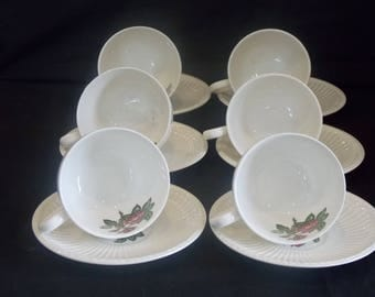 A Wedgewood and Barlaston Moss Rose Teaset. 6 Cup and Saucers and Side Plates. Milk Jug and a Sugar Bowl