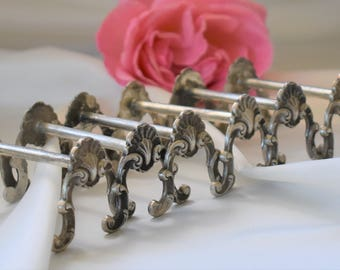 French vintage cutlery rests or knife rests with Art Nouveau style ends