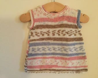 Hand knitted tunic dress for a 6 month old baby