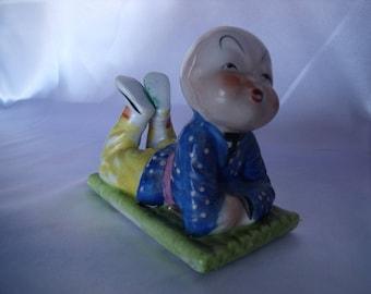 Occupied Japan Figurine, Little boy on mat