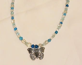 """Whimsical Clear Blue Beaded 18"""" Princess Style Necklace with a Silver Butterfly Pendant and a Lobster Clasp"""