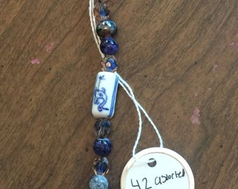 42 Assorted Blue and White Glass and Porcelain Beads