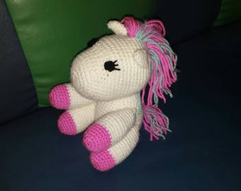 Toy pony knitting by hand