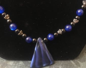 Black and blue pendant beaded necklace and earrings set