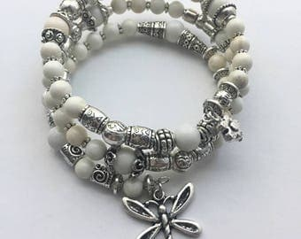White and silver memory wire bracelet with dragonfly charm